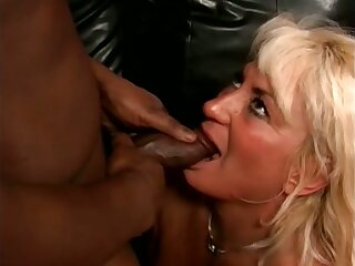 Bungler blonde mature slut stands on knees while sucking strong BBC